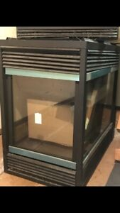 A majestic three sided Pier direct vent gas fireplace