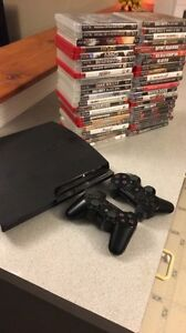 Mint condition PS3 with 44 games and two controllers