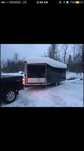 2 snowmobiles and a enclosed trailer