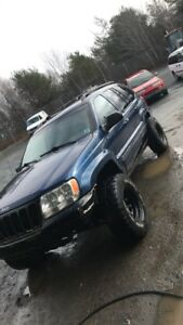 Nice wj with TONS of new lifetime warranty parts!!