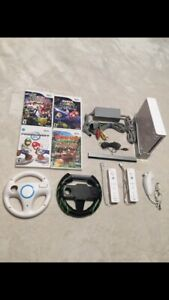 Nintendo wii console + 4 games + 2 wheels + 2 controllers + chuc