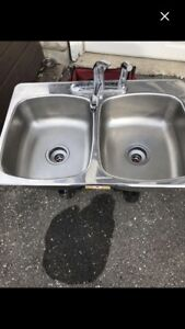 Kitchen stainless steel sink with taps