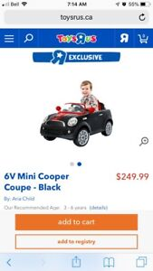 Mini Cooper 6V ride along toy car. Brand new and sealed
