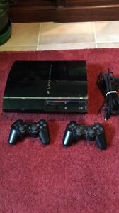 Playstation 3 + 2 Controllers + 10 Games!