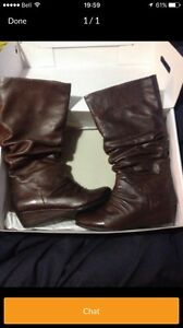Aldo leather boots in new condition