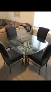 Wrought iron and glass kitchen table with 4 chairs and 4 covers