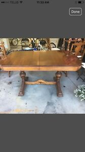 Antique dining room table with hutch.
