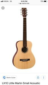 LOOKING to buy Martin lx1 guitar