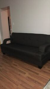 Dark grey sofa bed couch with storage