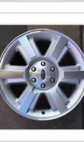 Selling four 20 inch chrome rims