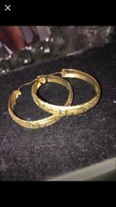 10k gold midsize hoop earrings.