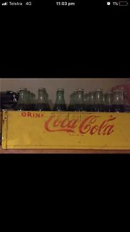 Original Collectors coke bottles fl oz in crate