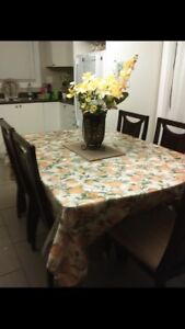 Leon's Dining table with chairs