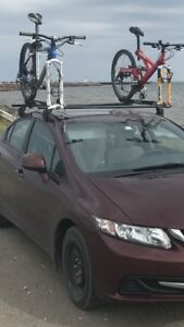 Yakima roof rack and 2 fork mount bike trays with locks.