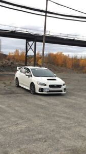 REDUCED: 2015 Subaru WRX STI SPORT TECH, very low kms !!