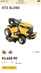 """Cub cadet 50""""lawn tractor with bagger."""