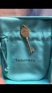 Brand new Tiffany & Co 18k Gold key. Never used