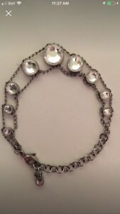 Silver Swatch bracelet with large spinning crystals