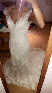 Never been worn or altered wedding gown
