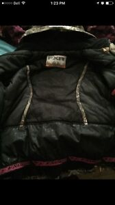 Woman's camo fxr winter coat only worn once, contact wit a offer