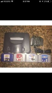 Nintendo 64 (N64) console with 4 games and 1 controller