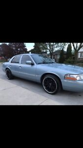 2005 Mercury Grand Marquis - 2 sets of rims and tires