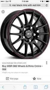 """17"""" black rims with red trim including low profile tires"""