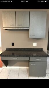 Kitchen cabinets/desk with stone countertop