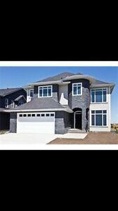 Estate 2-Storey home on the pond in Kinniburgh Chestermere.
