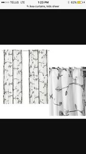 4 ikea sheer panel curtain panels. 2 with pattern, 2 without