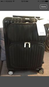 Reduced-Black Rimowa roller bag - carry-on -cabin size