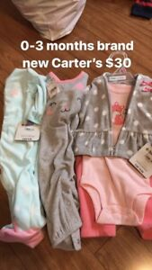 Mostly new baby girl Carter's items