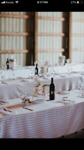 White Table cloths and colored cloth napkins.