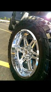 20x10 hostile havocs and 33x12.5 Toyo mt tires
