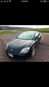 Standard Pontiac G5 GT 2 dr coupe on 17inch rims