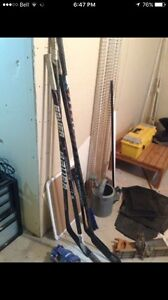 4 all left curved hockey sticks (total one has crack in blade)