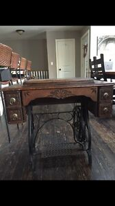 Antique sewing machine in table.