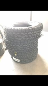 Three (3) 285/85r18 Toyo open country at 2
