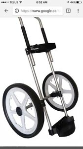 Golf pull cart. Rikshaw.  Can be taken apart in seconds