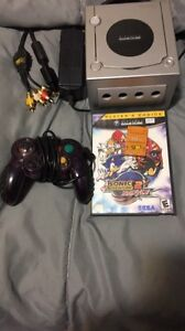 Gamecube with memory card, game, a controller and cables
