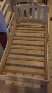 White wood toddler bed and white wood kitchen