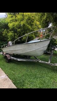 Boat tinnie with 8 hp Mariner and trailer