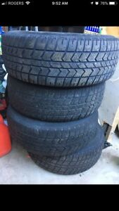 Set of 4 used tires and rims $125 OBO