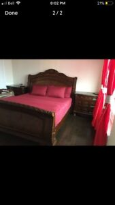 king italian bed with two side tables with granite top