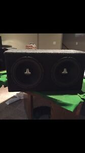 """Two 12"""" JL Audio subs with Phoenix Gold Amp and sub box"""