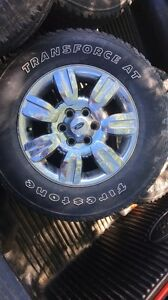 275 65 R18. Ford rims and tires