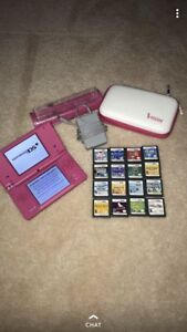 Pink Nintendo DSI with charger, case and 16 games