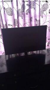 black rca tv with remote