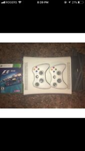 XBox 360 console with 4 games and 2 controllers