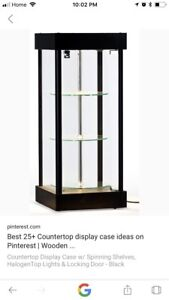 Counter top display cabinets with spinning shelves